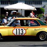 Die Gelbe Gefahr, ein Opel Commodore A, im historischen Fahrerlager auf dem Oldtimer Grand Prix 2016.